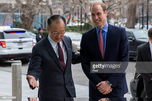 Prince William Duke of Cambridge is greeted by World Bank President Jim Yong Kim before delivering remarks on illegal transportation of wildlife...