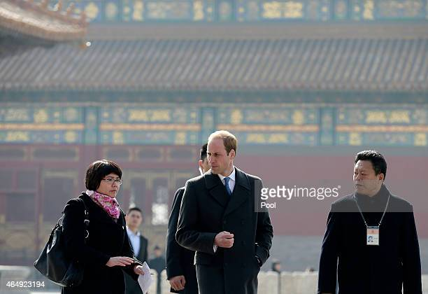 Prince William Duke of Cambridge is guided by Chinese officials as he tours the Forbidden City on March 2 2015 in Beijing China The Duke of Cambridge...