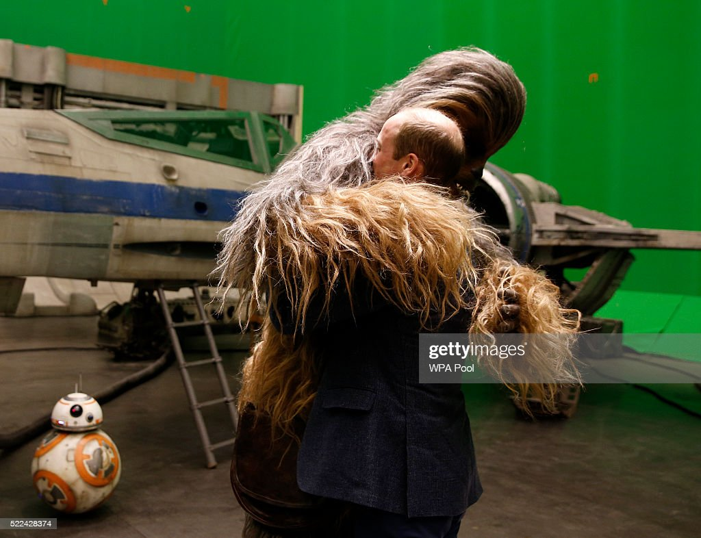 Prince William, Duke of Cambridge (R) is hugged by Chewbacca during a tour of the Star Wars sets at Pinewood studios on April 19, 2016 in Iver Heath, England. Prince William and Prince Harry are touring Pinewood studios to visit the production workshops and meet the creative teams working behind the scenes on the Star Wars films.
