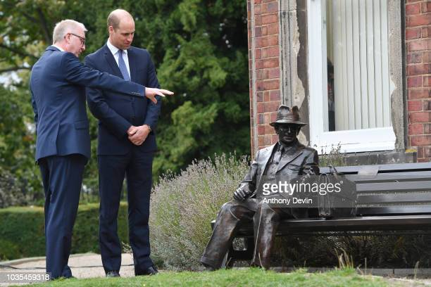 Prince William Duke of Cambridge is joined by Ian Austin MP as he unveils a new sculpture of Major Frank Foley by artist Andy de Comyn on September...