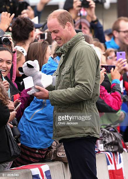 Prince William, Duke of Cambridge is presented with a bear as he meets members of the Canadian public after disembarking the tall ship Pacific Grace...