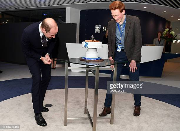 Prince William Duke of Cambridge is presented with a cake by Aerospace engineer and Great British BakeOff runnerup Aero Andrew Smyth during a visit...