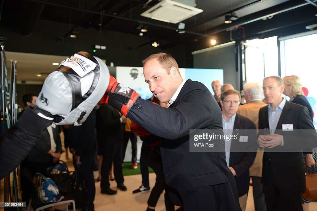 Prince William, Duke of Cambridge is seen boxing with Duke McKenzie at Queen Elizabeth Olympic Park during the launch of the Heads Together campaign on mental health on May 16, 2016 in London, England.
