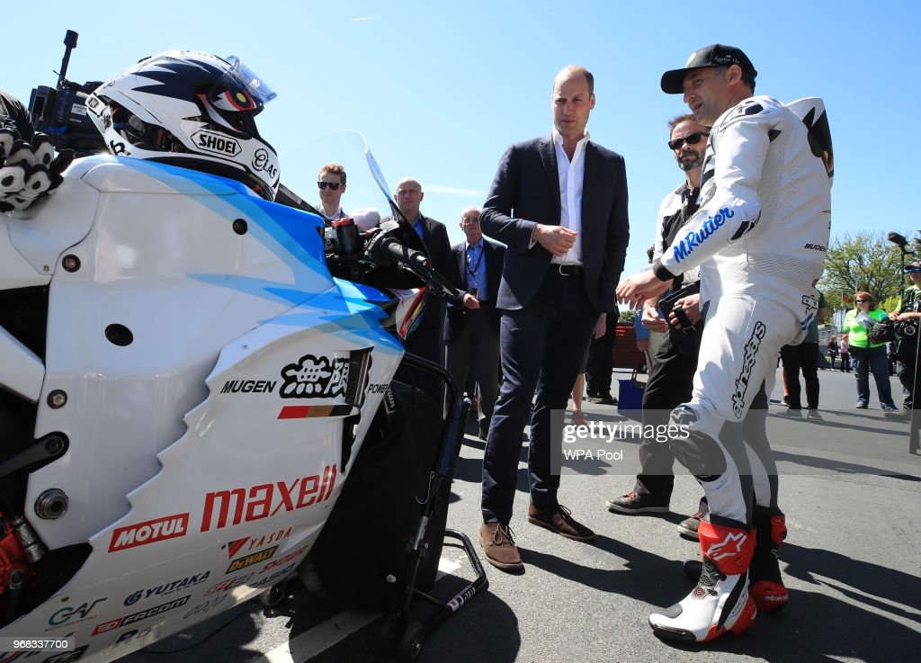 Prince William, Duke of Cambridge is shown a bike by motorcyclist Michael Rutter at the Isle of Man TT on June 6, 2018, Isle of Man, United Kingdom.