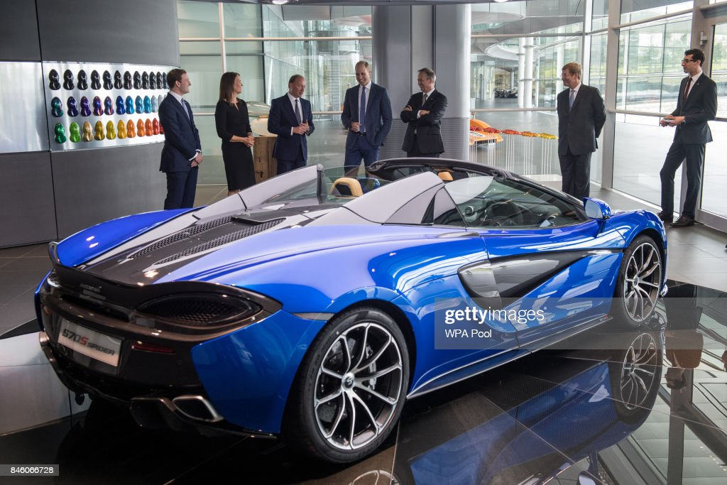 Prince William, Duke of Cambridge (C) is shown a McLaren 720S, by Mike Flewitt (3rd L), CEO of McLaren Automative during a visit to McLaren Automotive at McLaren Technology Centre on September 12, 2017 in Woking, England.