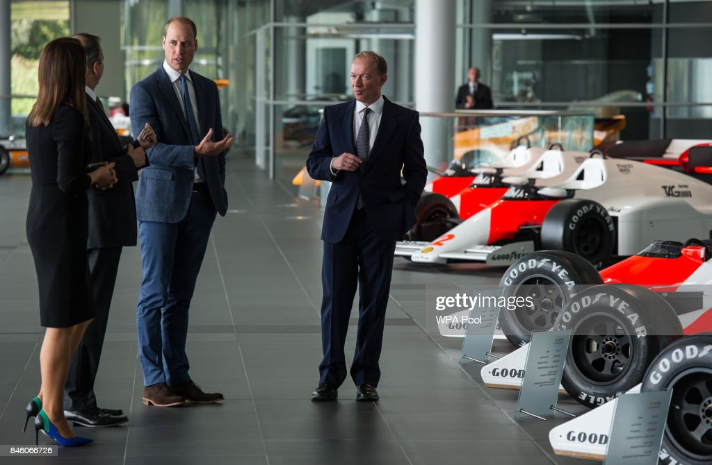 Prince William, Duke of Cambridge is shown Formula One racing cars previously used by Alain Prost and Ayrton Senna by Jonathan Neale (2nd L), chief operating officer of McLaren Technology Group, and Mike Flewitt (R), CEO of McLaren Automative during a visit to McLaren Automotive at McLaren Technology Centre on September 12, 2017 in Woking, England.