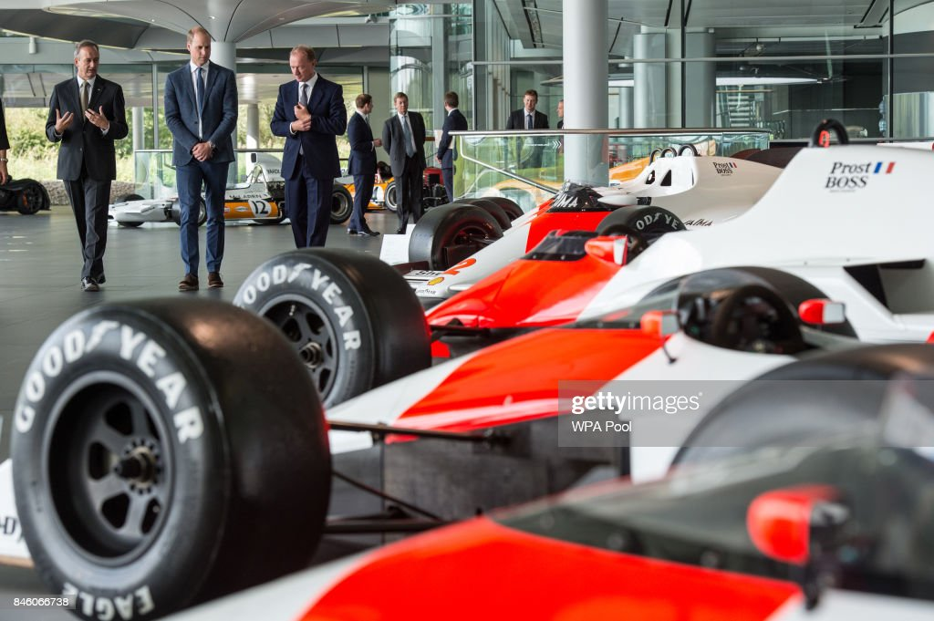Prince William, Duke of Cambridge is shown Formula One racing cars previously used by Alain Prost and Ayrton Senna in the McLaren Technology Centre by Jonathan Neale (L), chief operating officer of McLaren Technology Group, and Mike Flewitt (3rd L), CEO of McLaren Automative during a visit to McLaren Automotive at McLaren Technology Centre on September 12, 2017 in Woking, England.
