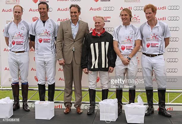 Prince William Duke of Cambridge John Paul Clarkin Andre Konsbruck Director of Audi UK Roddy Matthews Mark Tomlinson and Prince Harry attend day two...