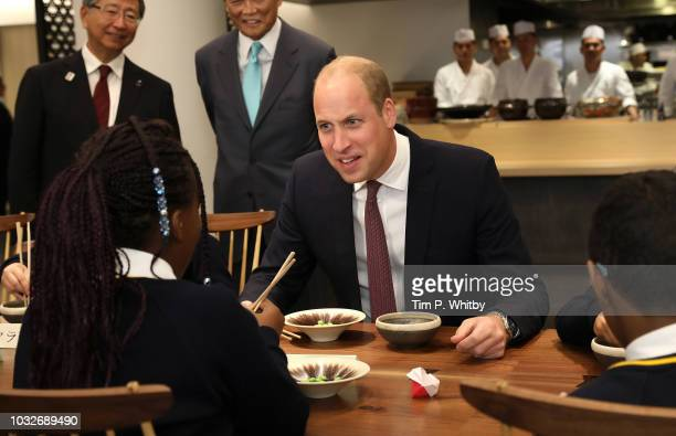 Prince William Duke of Cambridge prepares to take a sip of sake during The Official Opening of Japan House London the new Cultural Home of Japan in...