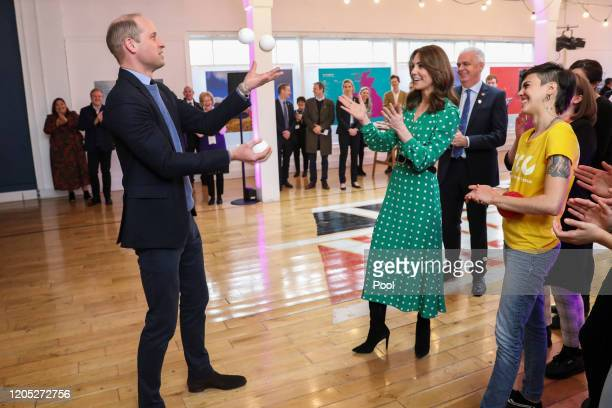 Prince William Duke of Cambridge juggles as Catherine Duchess of Cambridge watches during a meeting with Galway Community Circus performers local...