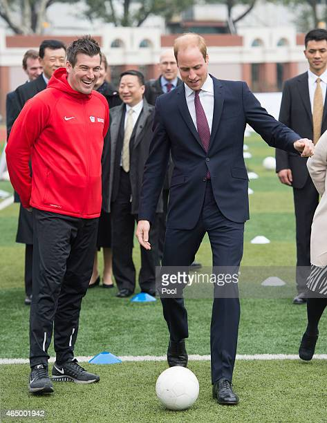 Prince William Duke of Cambridge kicks a ball as he attends a Premier Skills Football Event on March 3 2015 in Shanghai China Prince William Duke of...