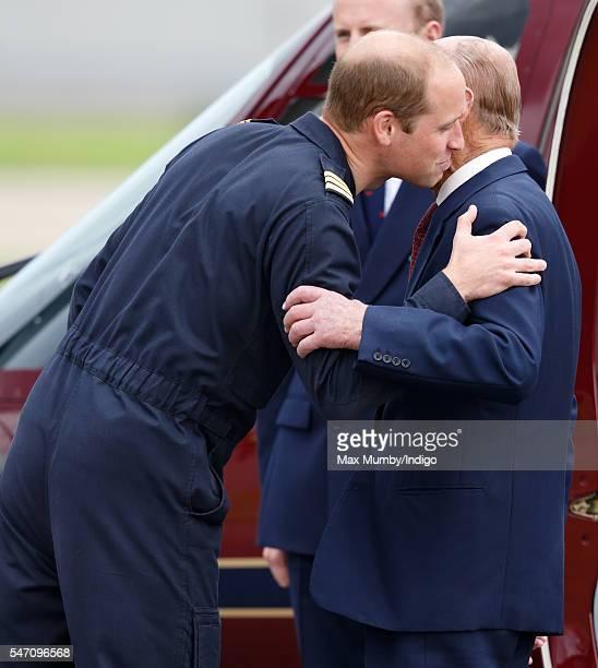 Prince William Duke of Cambridge kisses his grandfather Prince Philip Duke of Edinburgh goodbye after he opened the new East Anglian Air Ambulance...