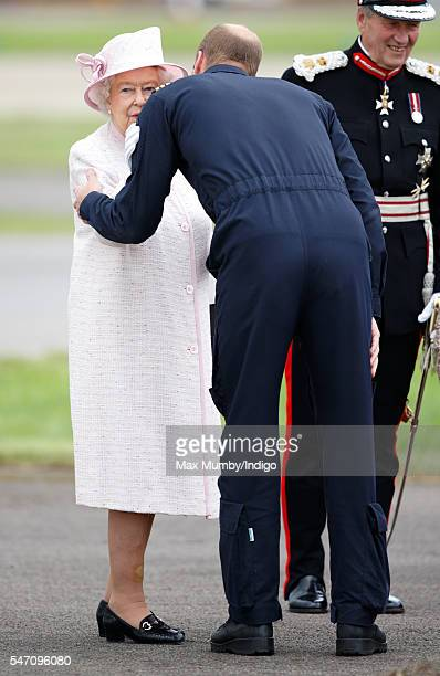 Prince William Duke of Cambridge kisses his grandmother Queen Elizabeth II goodbye after she opened the new East Anglian Air Ambulance base at...