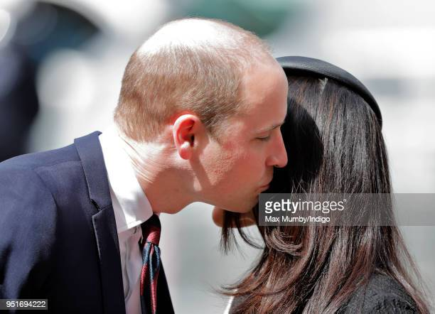 Prince William Duke of Cambridge kisses Meghan Markle as they attend an Anzac Day Service of Commemoration and Thanksgiving at Westminster Abbey on...