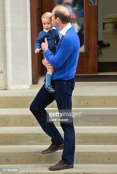 Prince William, Duke of Cambridge kisses Prince George as he arrives at the Lindo Wing following the birth his second child at St Mary's Hospital on...