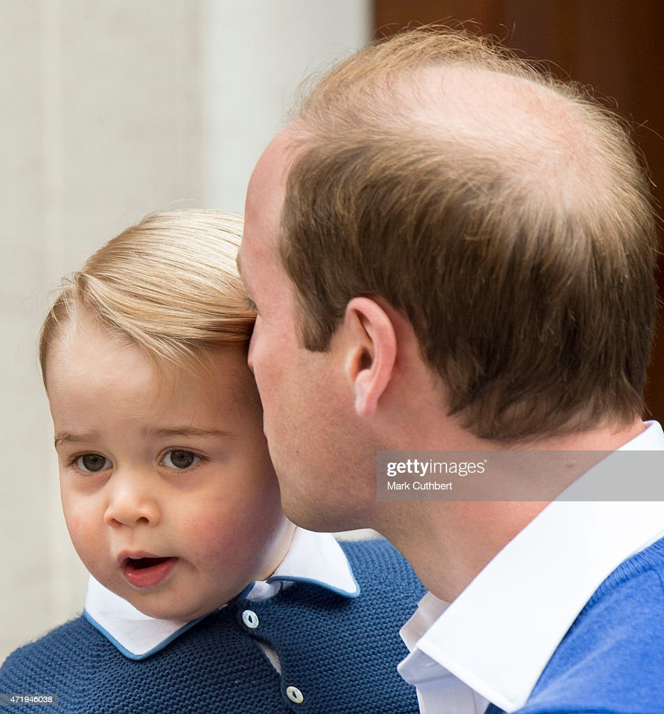Prince William, Duke of Cambridge kisses Prince George of Cambridge as they arrive at the Lindo Wing after Catherine, Duchess of Cambridge gave birth to a baby girl at St Mary's Hospital on May 2, 2015 in London, England.