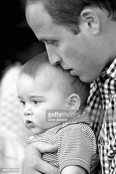 Prince William Duke of Cambridge kisses Prince George of Cambridge as they look at a Bilby called George at Taronga Zoo on April 20 2014 in Sydney...