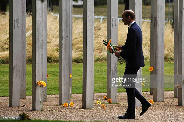 Prince William Duke of Cambridge lays a flower at the 52 steel pillar memorial to the victims of the July 7 2005 London bombings in Hyde Park on July...