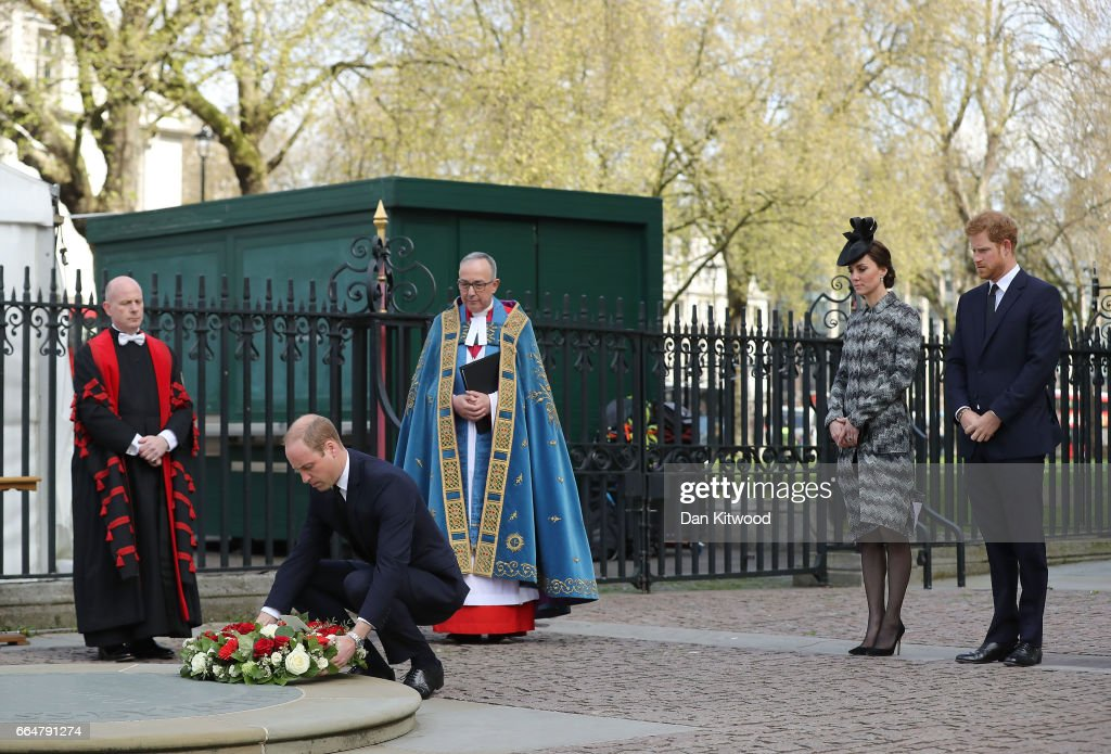 Prince William, Duke of Cambridge lays a wreath accompanied by Catherine, Duchess of Cambridge and Prince Harry during the Service of Hope at Westminster Abbey on April 5,2017 in London, United Kingdom. The multi-faith Service of Hope was held for the four people killed when Khalid Masood committed an act of terror in Westminster on Wednesday March 22. Survivors, bereaved families and members of the emergency services joined The Duke and Duchess of Cambridge, Prince Harry, the Home Secretary, Amber Rudd and London Mayor, Sadiq Khan, in the congregation.