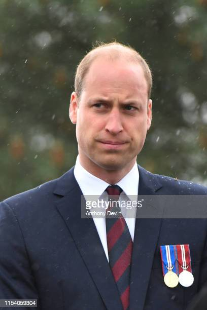 Prince William Duke of Cambridge lays a wreath at a service at the National Memorial Arboretum during an event to commemorate the 75th anniversary of...