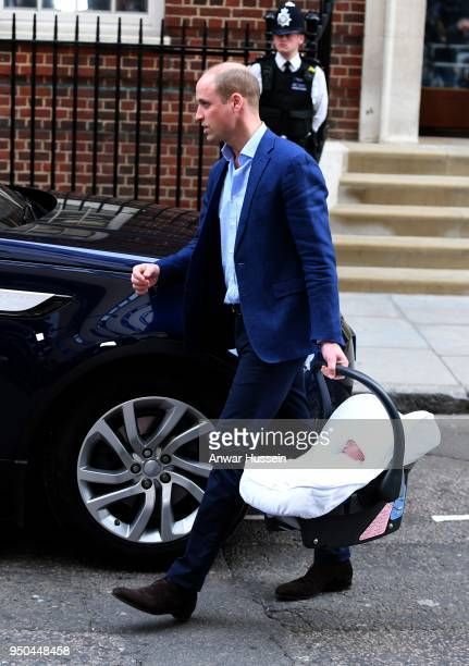 Prince William Duke of Cambridge leaves the Lindo Wing at St Mary's Hospital with his newborn son Prince Louis of Cambridge on April 23 2018 in...