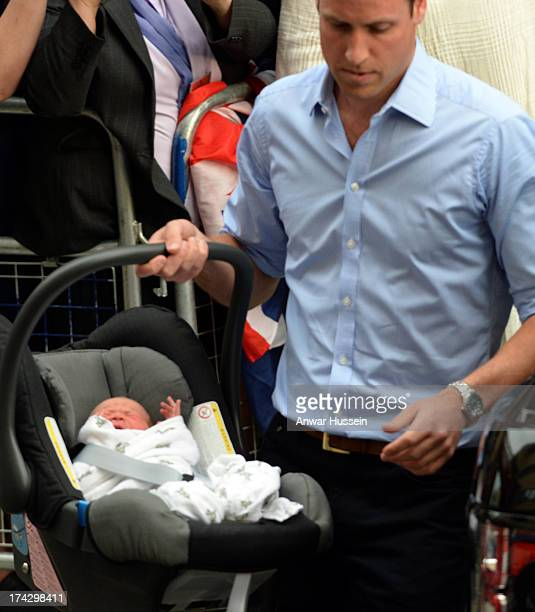 Prince William Duke of Cambridge leaves the Lindo Wing of St Mary's hospital carrying newborn son on July 23 2013 in London England