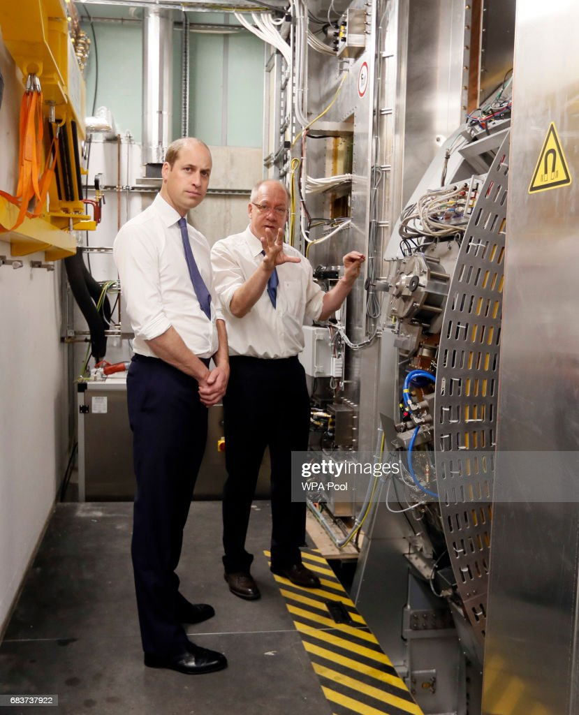 Prince William, Duke of Cambridge,, left, is shown the workings of an MR Linac machine by Professor Uwe Oelfke during a visit to the Royal Marsden hospital on May 16, 2017 in Sutton, England. The Duke of Cambridge, President of the Royal Marsden NHS Foundation Trust, visited the hospital's facilities in Sutton. During the visit, which marks 10 years since His Royal Highness became President of the centre, The Duke accompanied staff as they went about their daily activities in treating and caring for patients.