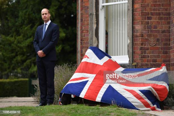 Prince William Duke of Cambridge listens to a speech by Ian Austin MP before unveiling a new sculpture of Major Frank Foley by artist Andy de Comyn...