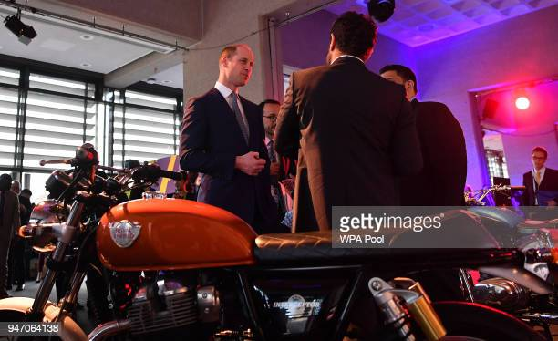 Prince William Duke of Cambridge looks at a display of Royal Enfield motorcycles during a 'Welcome to the UK' reception on the opening day of the...