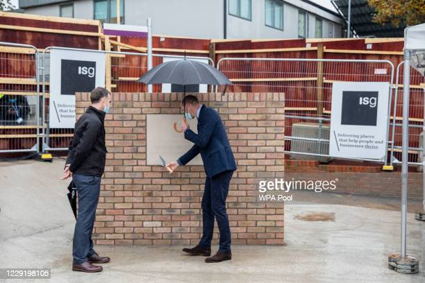 Prince William Duke of Cambridge looks at a plaque to mark the construction of the groundbreaking Oak cancer centre at Royal Marsden Hospital on...