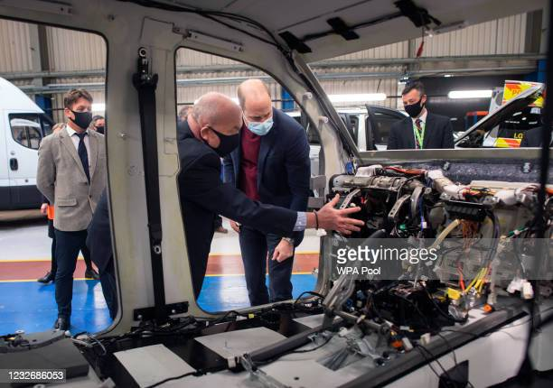 Prince William, Duke of Cambridge looks at a vehicle that has been striped back in preparation for blast and bullet protection at Babcock...