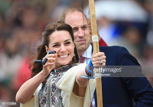 Prince William, Duke of Cambridge looks on as Catherine, Duchess of Cambridge fires an arrow during an Bhutanese archery demonstration on the first...