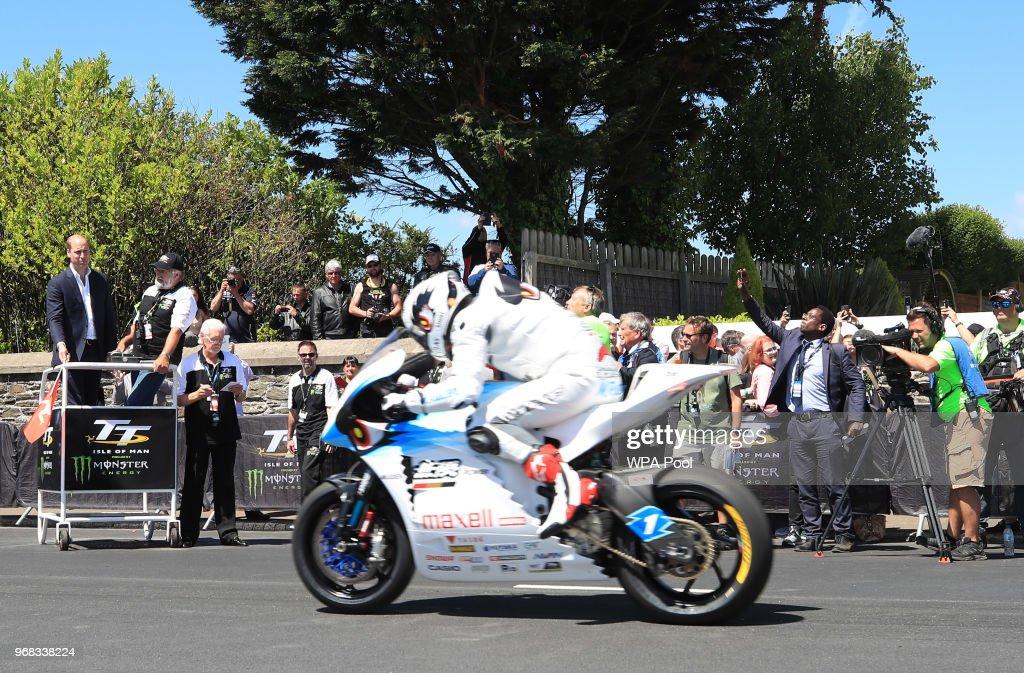 Prince William, Duke of Cambridge looks on as Isle of Man TT competitor Michael Rutter races past on his motorbike at the Isle of Man TT on June 6, 2018, Isle of Man, United Kingdom.