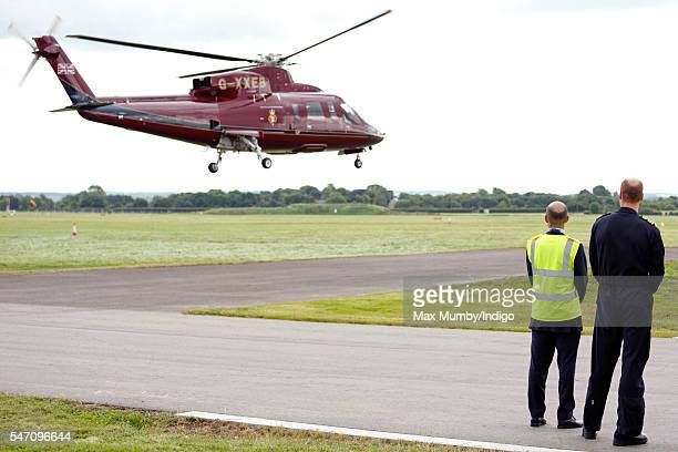 Prince William Duke of Cambridge looks on as Queen Elizabeth II and Prince Philip Duke of Edinburgh depart in a Sikorsky Helicopter after opening the...
