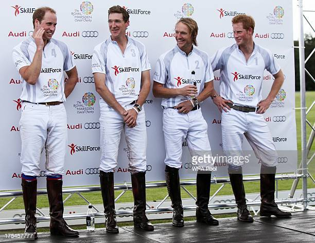 Prince William Duke of Cambridge Luke Tomlinson Mark Tomlinson Prince Harry share a laugh after competing in a charity polo match at the Audi Polo...