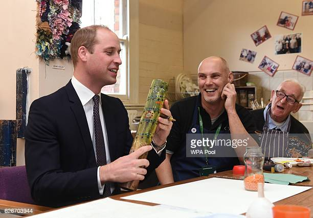 Prince William Duke of Cambridge makes a rainmaker instrument during a visit to Padley Development Centre on November 30 2016 in Derby England Padley...