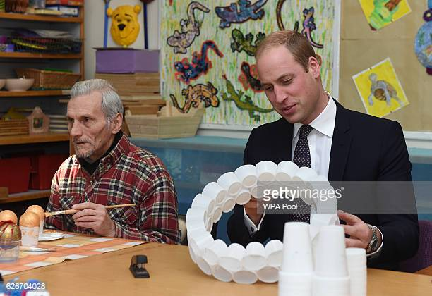 Prince William Duke of Cambridge makes Christmas decorations from plastic cups during a visit to Padley Development Centre on November 30 2016 in...