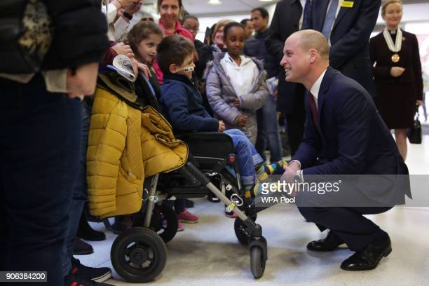 Prince William Duke of Cambridge meets a young patient during his visit to Evelina London Children's Hospital to launch a nationwide programme to...