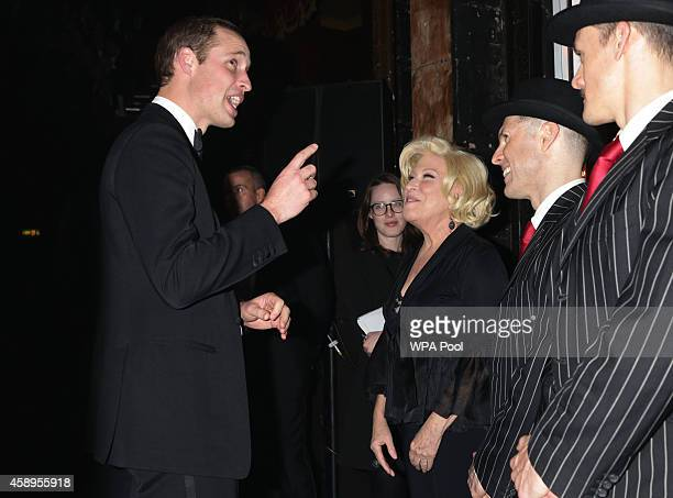 Prince William Duke of Cambridge meets Bette Midler at the end of The Royal Variety Performance at the London Palladium on November 13 2014 in London...