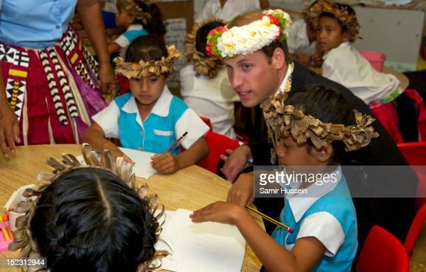 Prince William, Duke of Cambridge meets children at Nauti Primary School during the Royal couple's Diamond Jubilee tour of the Far East on September...