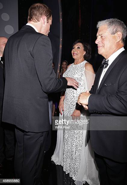 Prince William Duke of Cambridge meets Dame Shirley Bassey at the end of The Royal Variety Performance at the London Palladium on November 13 2014 in...