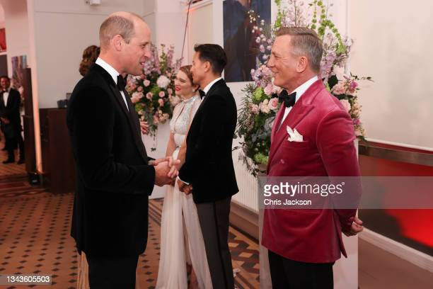 """Prince William, Duke of Cambridge meets Daniel Craig at the """"No Time To Die"""" World Premiere at Royal Albert Hall on September 28, 2021 in London,..."""