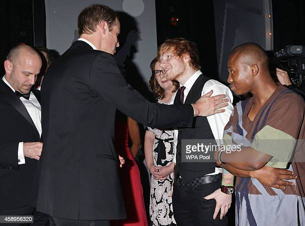 Prince William Duke of Cambridge meets Ed Sheeran as Sarah Millican looks on at the end of The Royal Variety Performance at the London Palladium on...