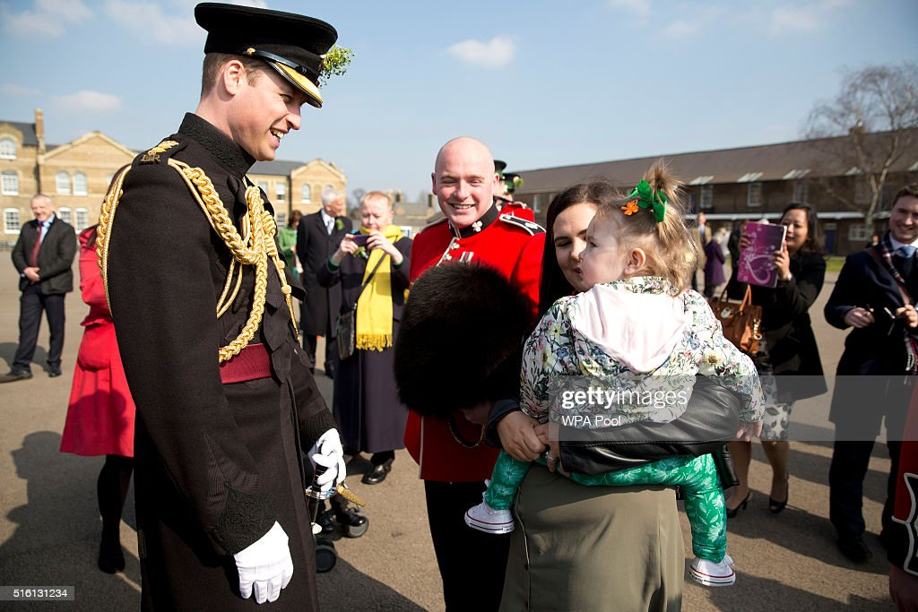 Prince William, Duke of Cambridge meets Guardsman Kenny Devon, his wife Rhiannon and daughter Sofia after the 1st Battalion Irish Guards for the St. Patrick's Day parade on March 17, 2016 in London, United Kingdom.