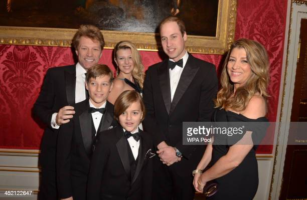 Prince William Duke of Cambridge meets Jon Bon Jovi and wife Dorothea Hurley and their children Jacob Stephanie and Romeo at Kensington Palace for...