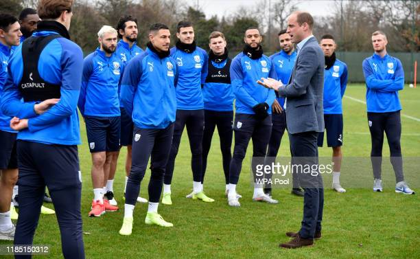 Prince William Duke of Cambridge meets members of West Bromwich Albion FC's first team as part of the Heads Up campaign at West Bromwich Albion...