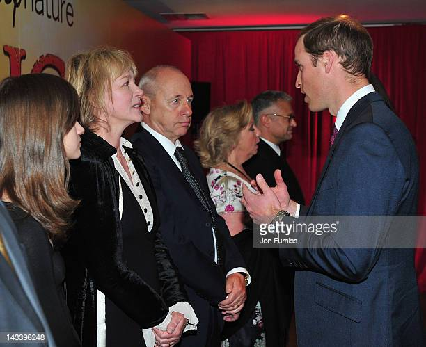 Prince William Duke of Cambridge meets musician Mark Knopfler and his wife Kitty Aldridge as he attends the African Cats UK film Premiere in Aid of...