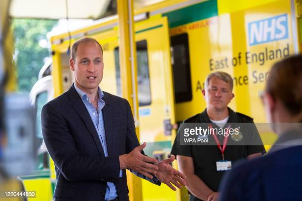Prince William Duke of Cambridge meets paramedic staff maintaining social distancing from the East of England Ambulance Service Trust during a visit...