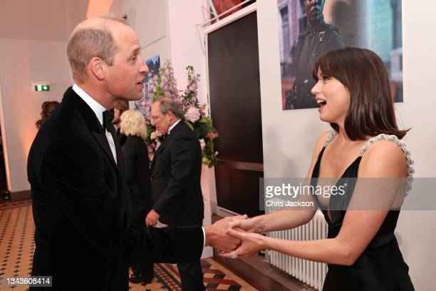 """Prince William, Duke of Cambridge meets some of the cast including Ana de Armas at the """"No Time To Die"""" World Premiere at Royal Albert Hall on..."""
