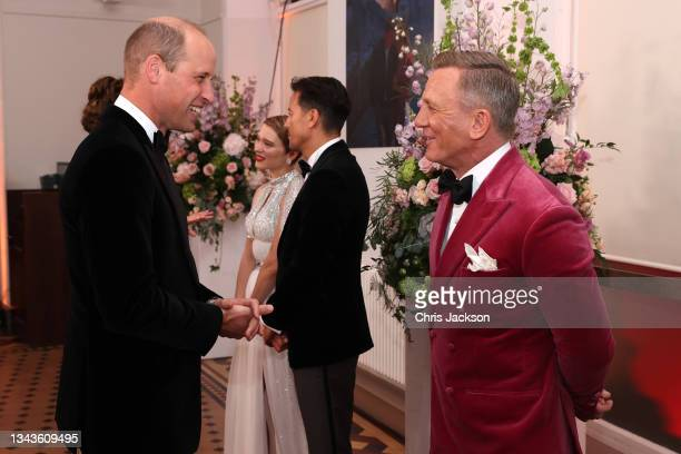 """Prince William, Duke of Cambridge meets some of the cast including Daniel Craig at the """"No Time To Die"""" World Premiere at Royal Albert Hall on..."""